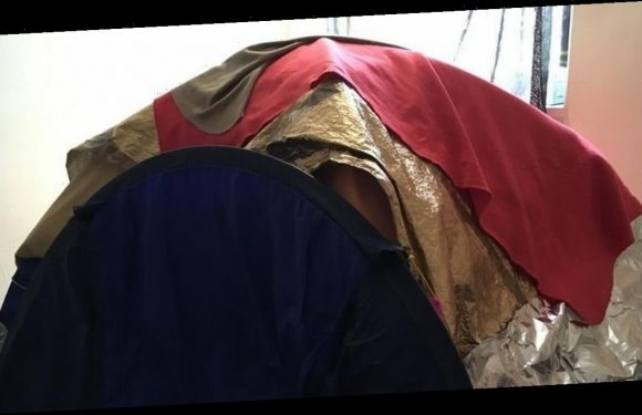 Woman who fears phone mast radiation is making her ill sleeps in foil tent