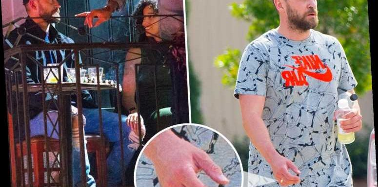 Justin Timberlake puts his wedding ring back ON after apologising to wife Jessica Biel for holding hands with co-star