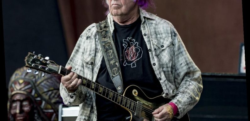 Neil Young, recently naturalized American, calls Trump a 'disgrace to my country'