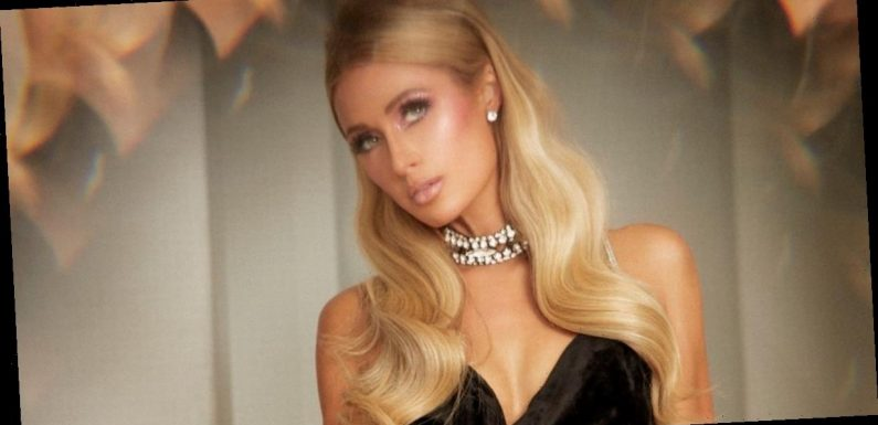 Paris Hilton strips to bodysuit and thigh-high boots for sexy isolation snaps