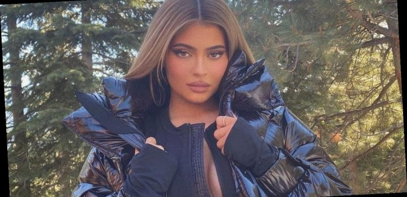 Kylie Jenner parades boobs as she ditches bra under unzipped skintight snowsuit