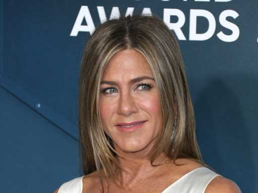 Jennifer Aniston Cuddles Up to Her Own Reflection in This Seriously Sexy Photo