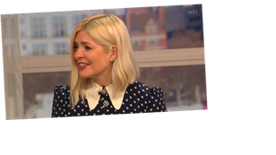 Holly Willoughby is 'holding on' as she returns to This Morning after missing two days of show