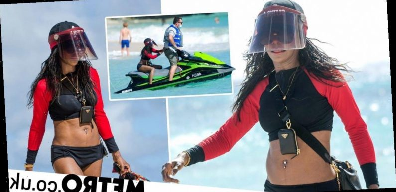 Sinitta, 52, hops on jet ski as she rings in 2021 with Simon Cowell in Barbados