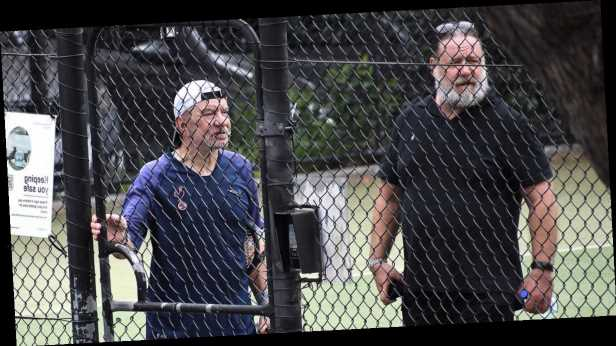 Russell Crowe and Lord Alan Sugar make an unlikely pair as they are spotted playing tennis in Australia
