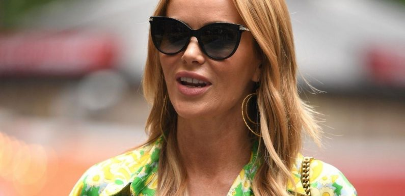 Amanda Holden dazzles as she flashes legs in a colourful summer minidress