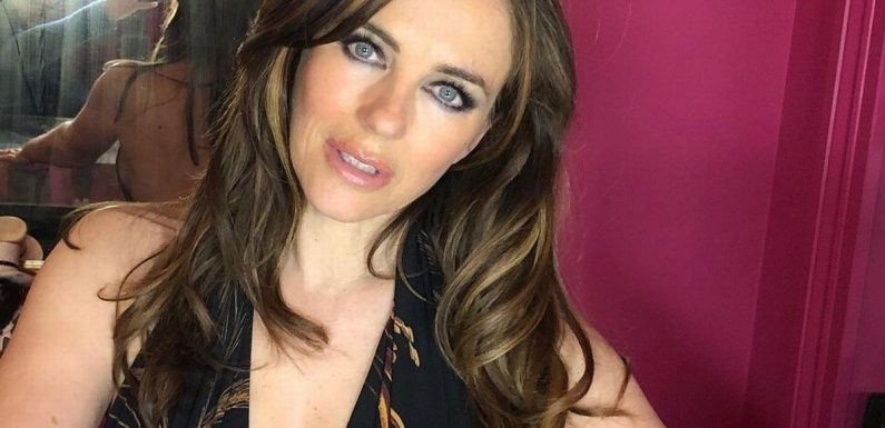 Liz Hurley, 56, flashes famous curves as she wows in plunging black dress